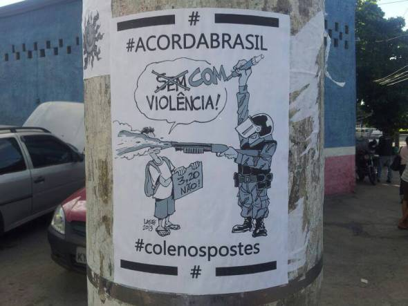 A charge do Latuff virou cartaz de rua em Sampa